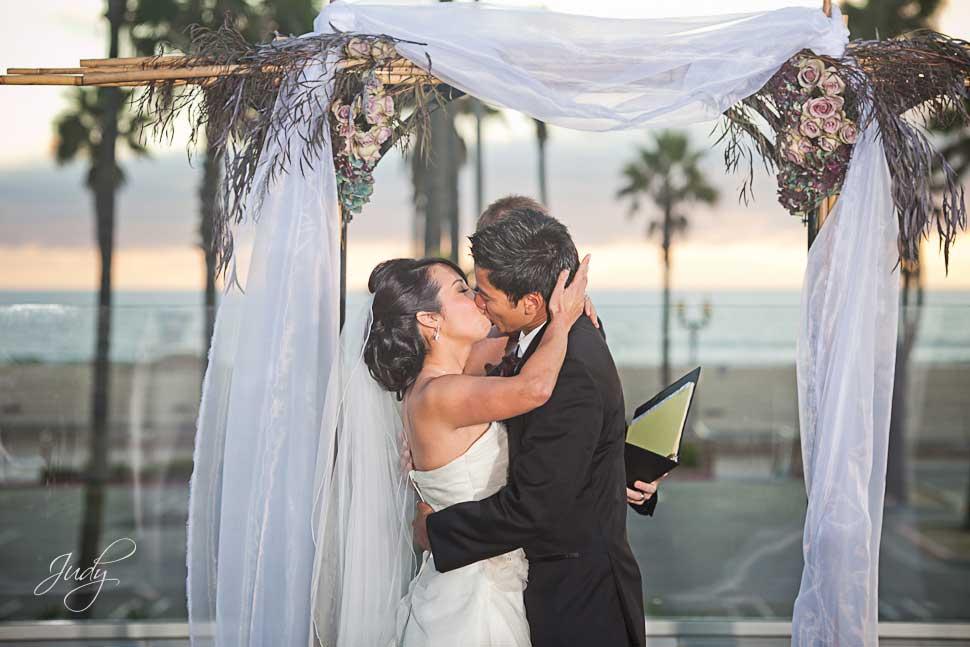 Huntington Hyatt wedding ceremony First Kiss
