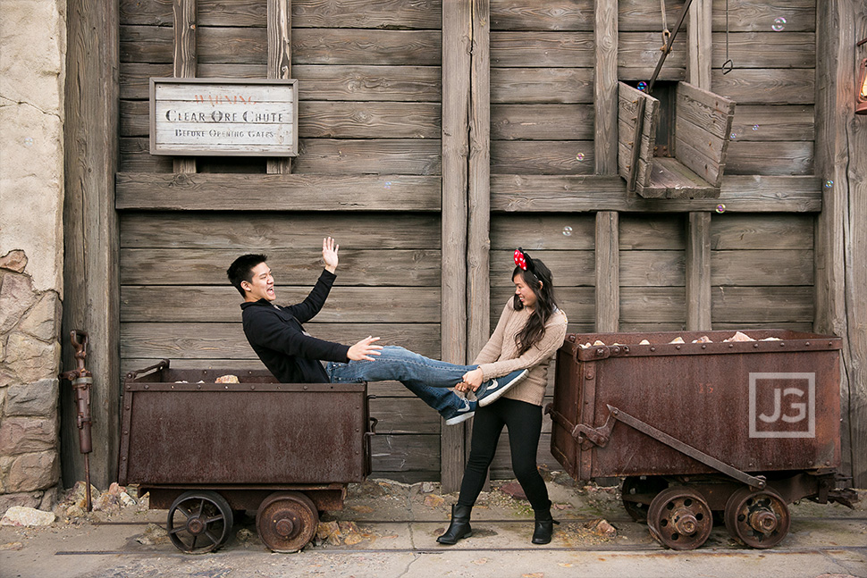 Engagement photos at California Adventures with Mining Carts