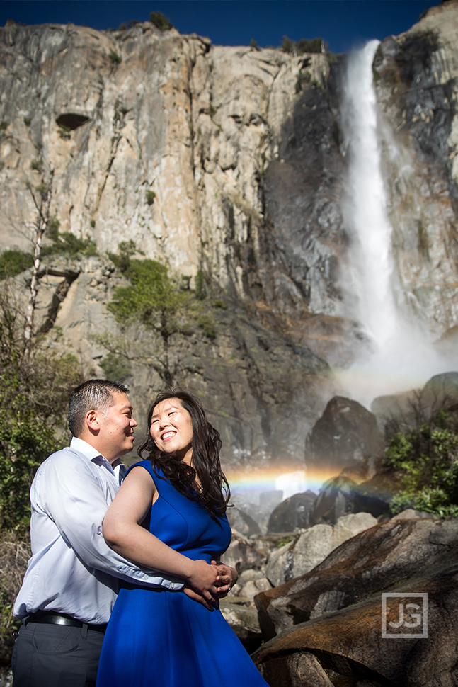 Yosemite engagement photography with waterfall and rainbow