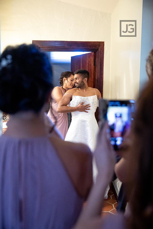 Groomsmen wearing a white wedding dress