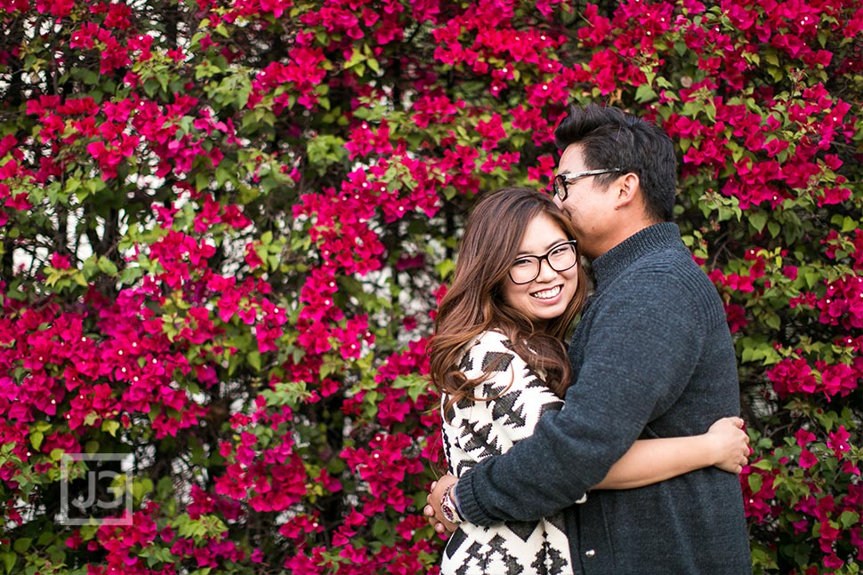 Engagement Photos with Red Flowers