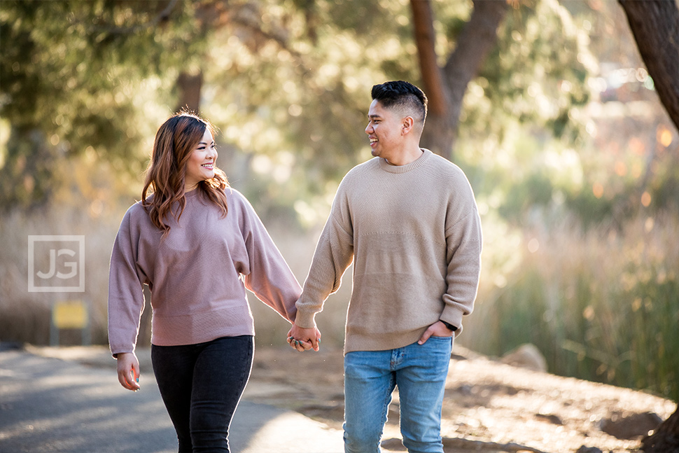 Walking along a Park Trail Engagement Photography