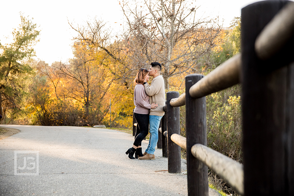 Park Trail Engagement Photography with a Wooden Fence