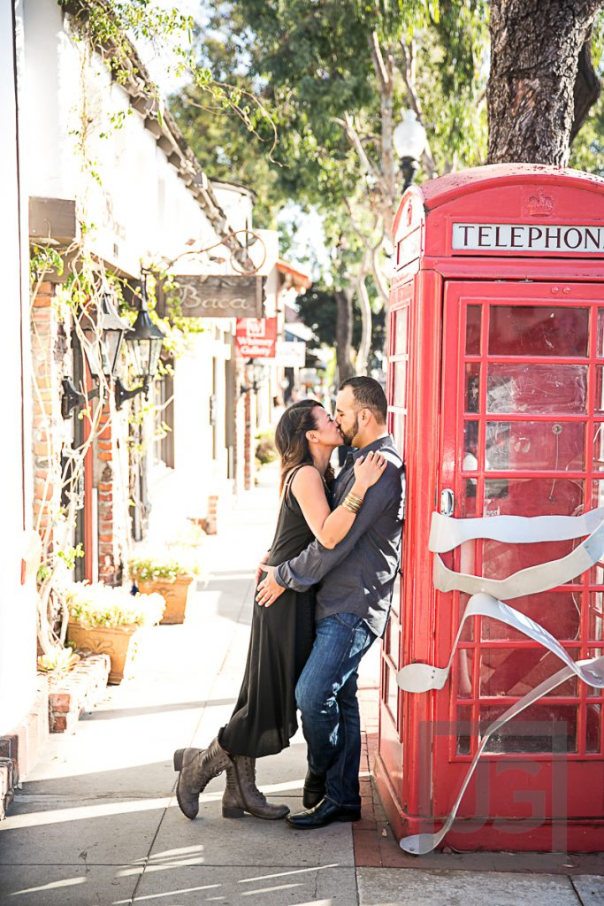 downtown Laguna Beach engagement photo, red phone booth