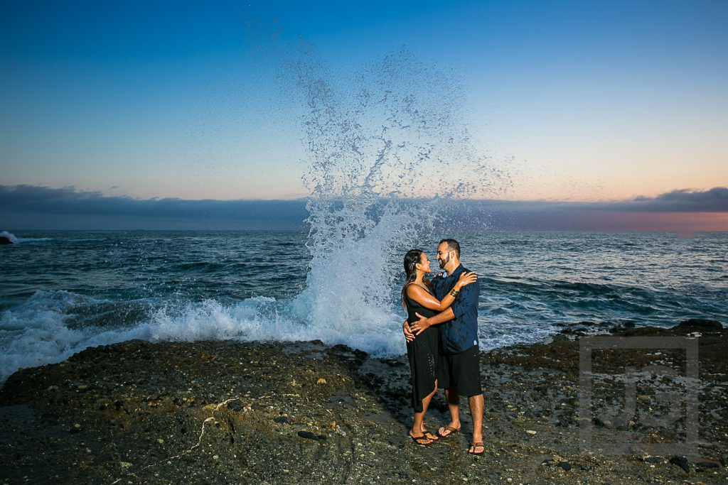 Laguna Beach Engagement Photo with wave and sunset