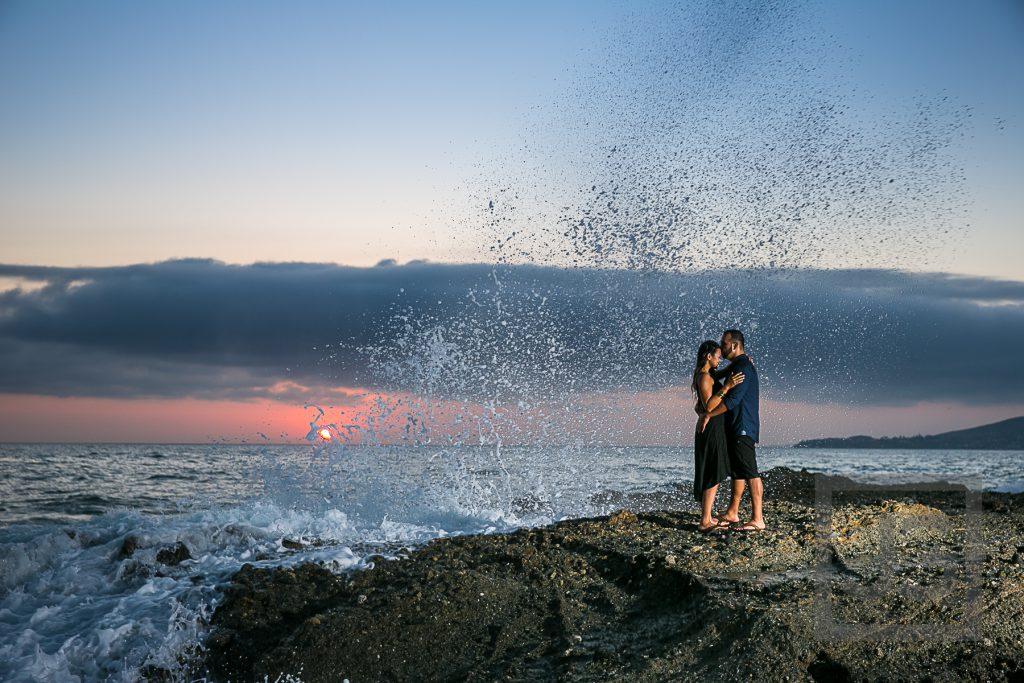 Laguna Beach Engagement Photo with wave and sunset
