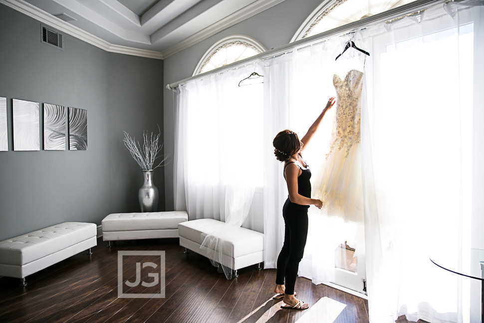 Bride reaching for her wedding dress
