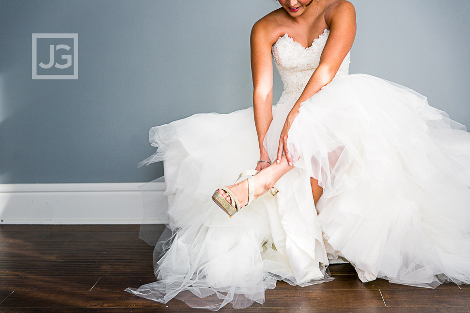 Bride putting on her Jimmy Choos